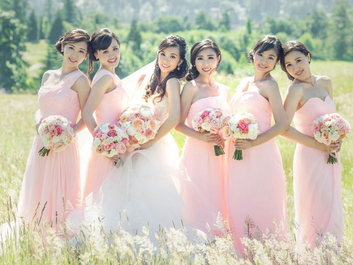 Newcastle Golf Club bride with bridesmaids peach blush