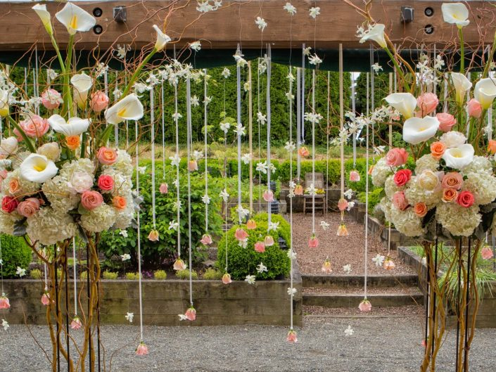 Seattle-Floral-Design-wedding-ceremony-arch-hanging-flowers-peony-calla-lilies-roses-Willow-Lodge