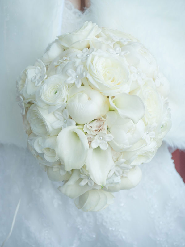 This White Tight Cascade Bridal Bouquet Made Of Peonies Elegant Calla Lilies Delicate Ranunculus Fragrant Stephanotis And Garden Roses