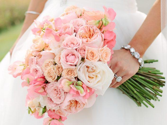 Brides bouquet peach blush coral