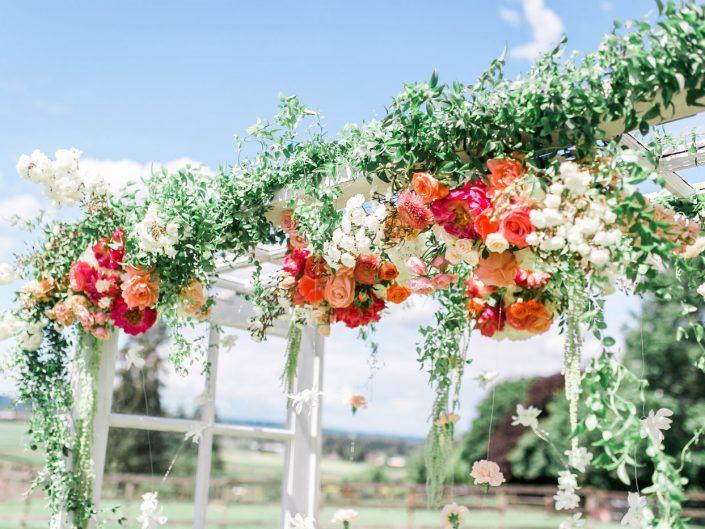 barn-ceremony-arch-peach-blush-coral-peony