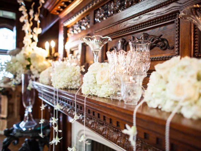 Thornwood Castle mantel roses orchids pearls