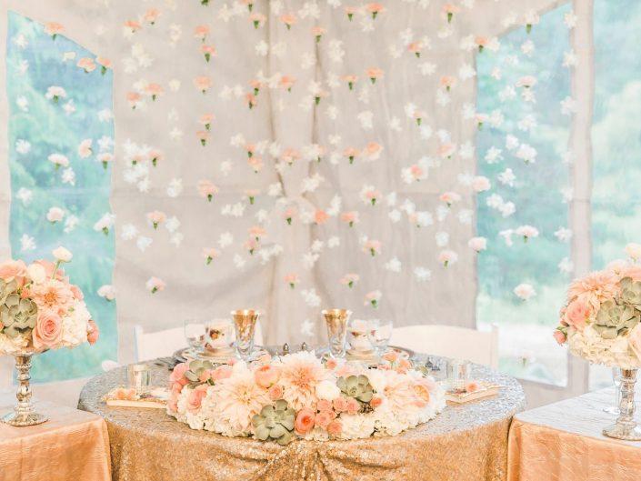 Wedding centerpiece roses hydrangea succulent dusty miller